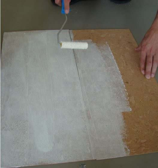 apply cork adhesive evenly and fully to cork backing