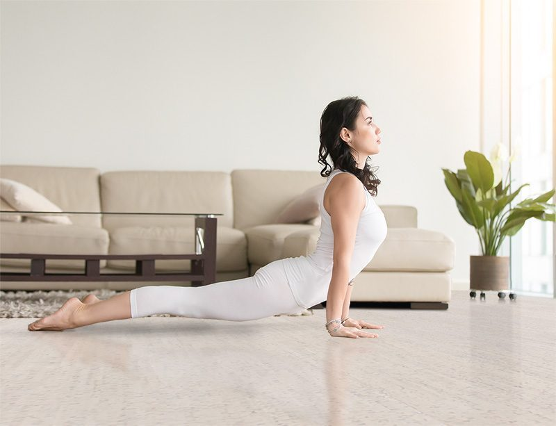 bleached birch cork floor young attractive woman practicing yoga luxury home