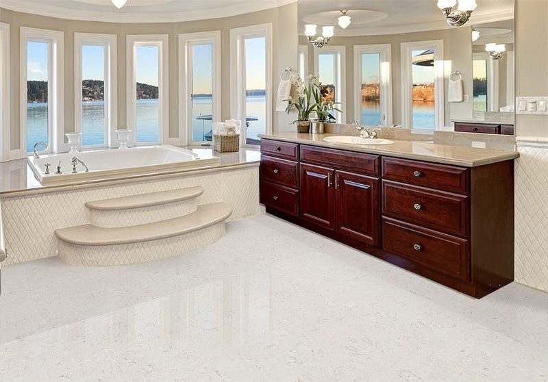ceramic marble forna waterproof cork tiles in luxurious master bathroom interior boasts jetted tub with curved windows facing the lake cherrywood vanity cabinets