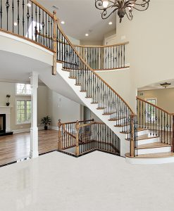 creme royal marble cork floor foyer curved staircase luxury home