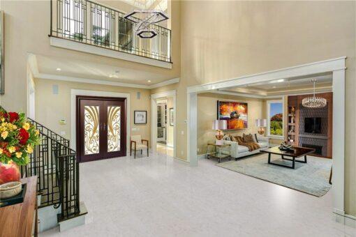 creme royal marble cork floors staircase wrought iron railing