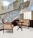creme royal marble cork floors staircase wrought iron railing