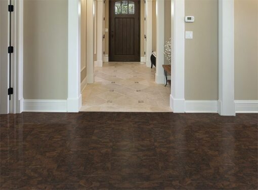 gemwood cork flooring foyer in new construction home with arched entry