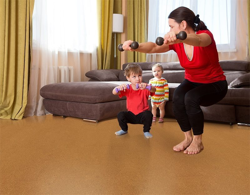 golden bach cork floor exercising happy mother and son dumbbell