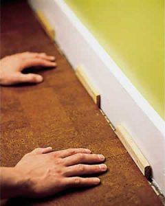 insert spacers along walls install cork floor