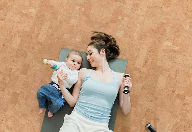 leather cork floor top view mother baby boy lying