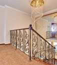 ripple beveled cork flooring staircase wrought iron railing