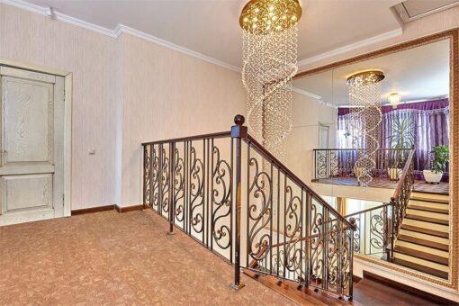 ripple beveled cork flooring staircase wrought iron railing