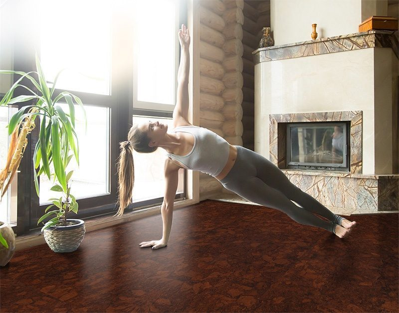 sunny ripple young attractive woman practicing yoga near fireplace