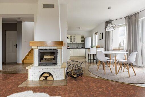 tasmanian burl forna cork floor foyer in luxury home with cherry wood flooring