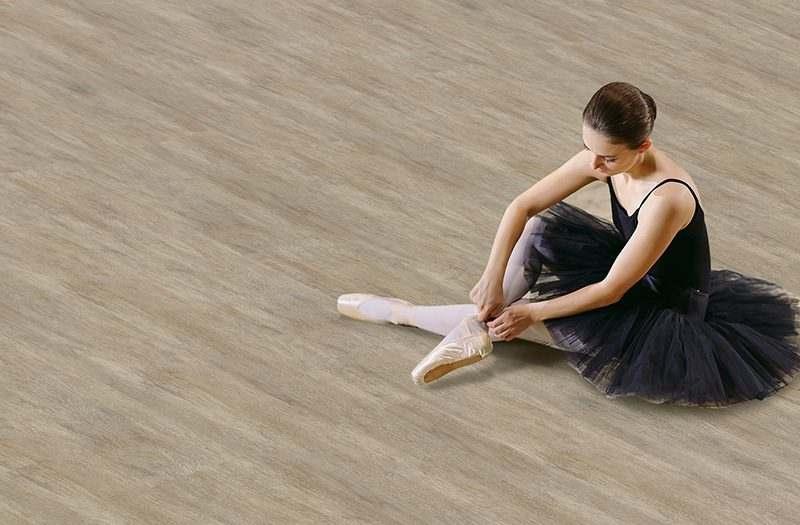 teak fusion cork floor ballerina in black dress trains at home
