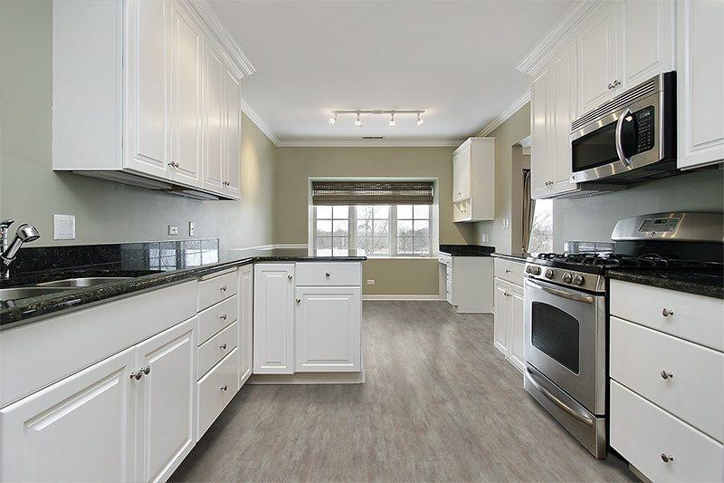 teak fusion cork floor modern kitchen interior design white cabinet stainless steel microwave above stove