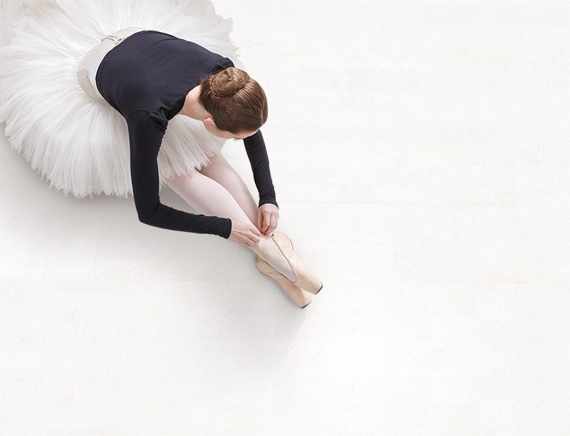 white leather forna cork floor top view ballet dancer practice stretching
